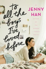 Cover of To all the Boys... the title and author's name write large over an image of a teenager of Asian descent gazing longingly off into the distance as she sprawls across her bed, writing a letter.